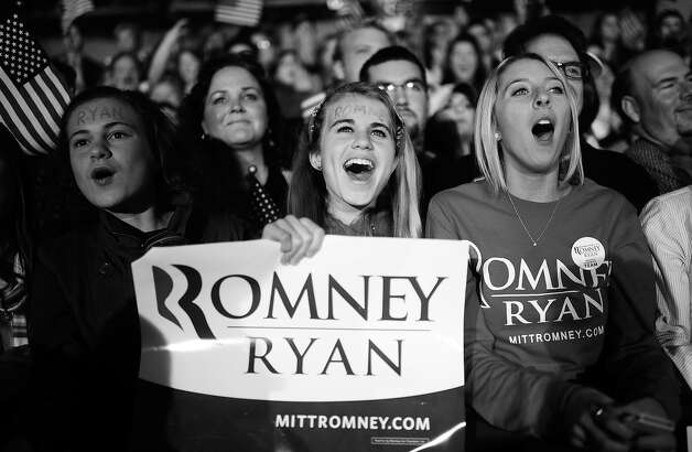 BLACK AND WHITE VERSION US Republican Presidential candidate Mitt Romney supporters attend a rally in Columbus, Ohio, November 5, 2012.  AFP PHOTO/Emmanuel DUNAND Photo: EMMANUEL DUNAND, AFP/Getty Images / 2012 AFP