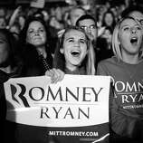 BLACK AND WHITE VERSION US Republican Presidential candidate Mitt Romney supporters attend a rally in Columbus, Ohio, November 5, 2012.  AFP PHOTO/Emmanuel DUNAND