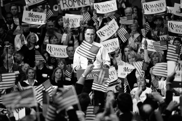 BLACK AND WHITE VERSION US Republican presidential candidate Mitt Romney speaks during a campaign rally at George Mason University on November 5, 2012 in Fairfax, Virginia. After a grueling 18-month battle, the final US campaign day arrived for President Barack Obama and Republican rival Mitt Romney, two men on a collision course for the world's top job. The candidates have attended hundreds of rallies, fundraisers and town halls, spent literally billions on attack ads, ground games, and get out the vote efforts, and squared off in three intense debates.  AFP PHOTO/Mandel NGAN Photo: MANDEL NGAN, AFP/Getty Images / 2012 AFP