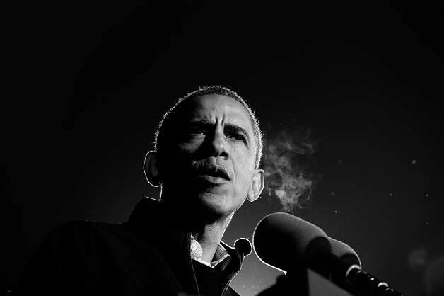 BLACK AND WHITE VERSION US President Barack Obama speaks at his last campaign rally in Des Moines, Iowa, on November 5, 2012. After a grueling 18-month battle, the final US campaign day arrived Monday for Obama and Republican rival Mitt Romney, two men on a collision course for the world's top job. The candidates have attended hundreds of rallies, fundraisers and town halls, spent literally billions on attack ads, ground games, and get out the vote efforts, and squared off in three intense debates. AFP PHOTO/Jewel Samad Photo: JEWEL SAMAD, AFP/Getty Images / 2012 AFP