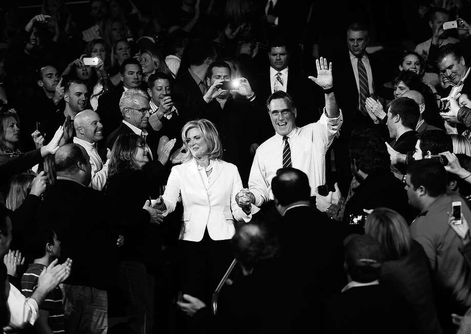 BLACK AND WHITE VERSION US Republican Presidential candidate Mitt Romney and his wife Ann arrive during his last campaign rally in Manchester, New Hampshire, November 5, 2012.  AFP PHOTO/Emmanuel DUNAND Photo: EMMANUEL DUNAND, AFP/Getty Images / 2012 AFP