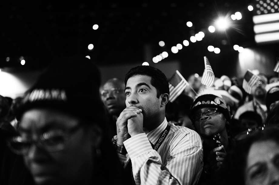BLACK AND WHITE VERSION Supporters of US President Barack Obama react to results on election night November 6, 2012 in Chicago, Illinois.  AFP PHOTO / Robyn Beck Photo: ROBYN BECK, AFP/Getty Images / 2012 AFP