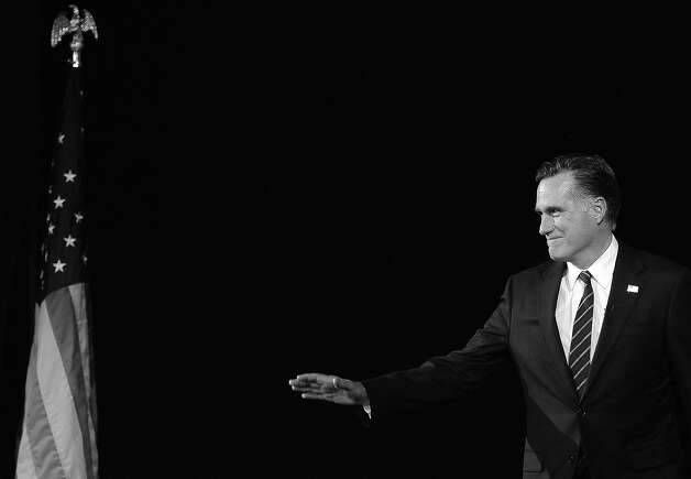 BLACK AND WHITE VERSION Republican presidential candidate Mitt Romney arrives on stage on election night November 7, 2012 in Boston, Massachusetts, moments before conceding defeat to US President Barack Obama in the 2012 US presidential election.     AFP PHOTO/EMMANUEL DUNAND Photo: EMMANUEL DUNAND, AFP/Getty Images / 2012 AFP