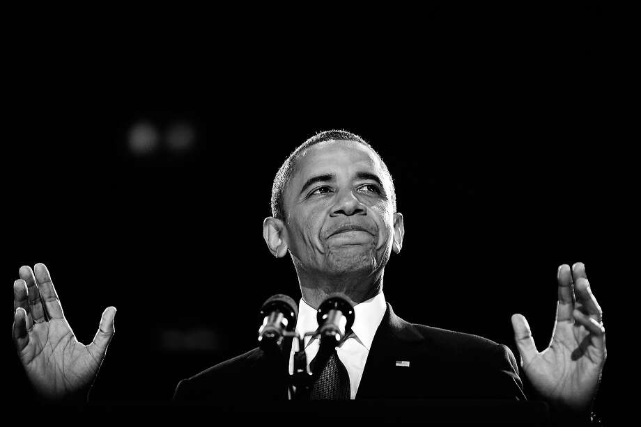 BLACK AND WHITE VERSION US President Barack Obama addresses a crowd of supporters on stage on election night November 6, 2012 in Chicago, Illinois. President Barack Obama swept to re-election Tuesday, forging history again by transcending a slow economic recovery and the high unemployment which haunted his first term to beat Republican Mitt Romney. AFP PHOTO/Jewel Samad Photo: JEWEL SAMAD, AFP/Getty Images / 2012 AFP