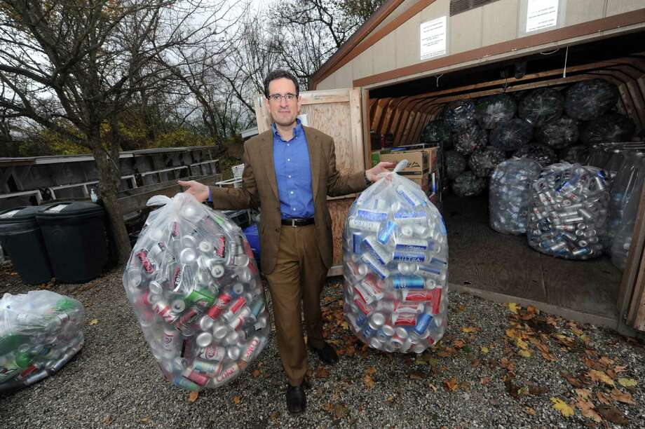 Brad Shear, the humane society's director, with donated recyclable bottles and cans at Mohawk Hudson Humane Society in Menands , NY Wednesday Oct. 31, 2012. (Michael P. Farrell/Times Union) Photo: Michael P. Farrell
