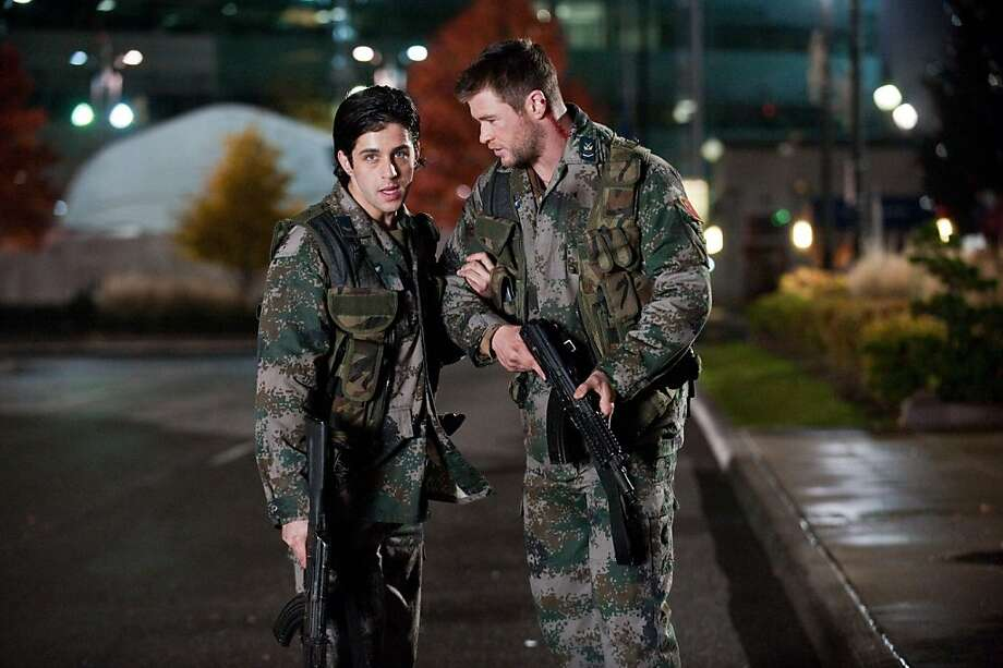 "Josh Peck (left) and Chris Hemsworth fight North Koreans in ""Red Dawn."" Photo: Open Road Films"