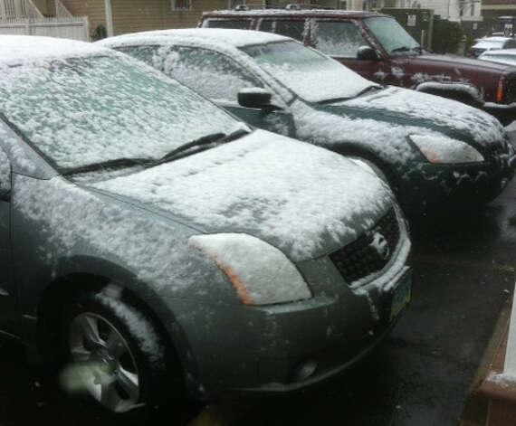 Snow coats cars parked downtown at midday Wednesday as the leading edge of a nor'easter moved into the region. Fairfield CT 11/7/12 Photo: John Schwing / Fairfield Citizen contributed