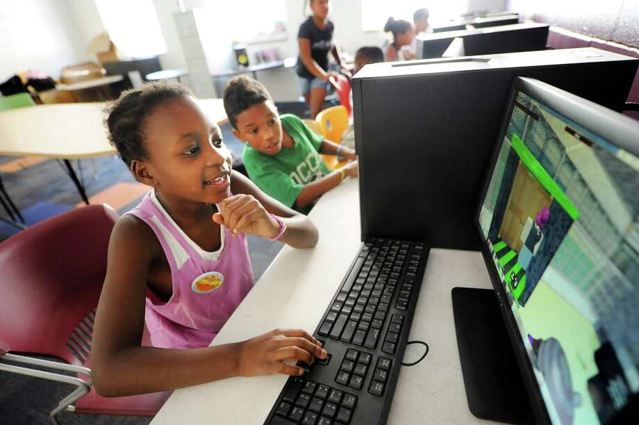 Alayia Campbell, 8, left, and her brother Deveon Gordon, 7, play an interactive computer game during Camp Barker at Troy Boys and Girls Club in Troy, N.Y. Over 100 kids attended the camp this summer. (Cindy Schultz / Times Union ARCHIVE) Photo: Cindy Schultz / 00019015A
