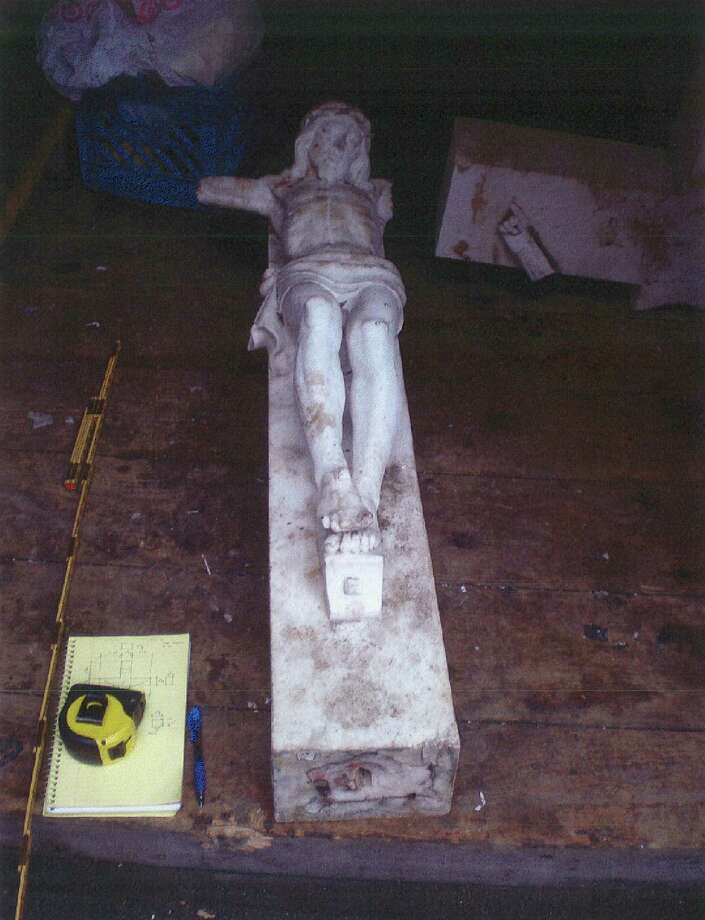 An outdoor crucifix that used to stand at St. Patrick's Church in the city of Newburgh, N.Y. is seen in an undated photo provided by the Kitson Law Firm. David Jiminez, an immigrant from Mexico, was so elated over his wife's recovery from cancer that he offered to clean the large crucifix outside St. Patrick's Church in Newburgh, where he spent many hours praying for her to beat the disease. He was scrubbing grime off the 600-pound marble cross when it toppled onto him, crushing his right leg, which had to be amputated. Jimenez is now suing the Roman Catholic church where he was hurt, and his $3 million lawsuit is scheduled to go to trial next year. (AP Photo/Kitson Law Firm)
