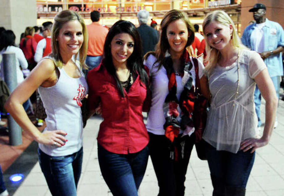 Kristen Cooke, Christie Contreras, Ginger Kiser and Susie Shaw make it a girls night at the first Rockets home game of the 2012-13 season against the Portland Trail Blazers on Sat. Nov 3. (Buck Bedia / For the Chronicle)