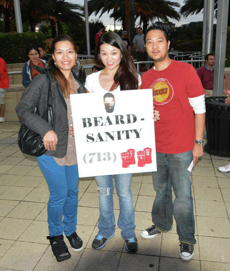 Claire Weber, Ada Lau, and Ahren Castro brought this clever sign to the first Rockets home game of the 2012-13 season against the Portland Trail Blazers on Sat. Nov 3. (Buck Bedia / For the Chronicle)