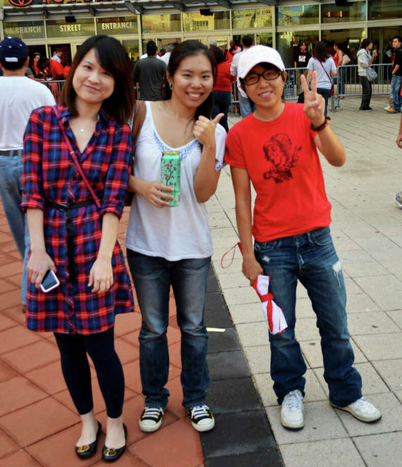 Nanyen Chou, Yen Wen Yang & Danielle Lee at the first Rockets home game of the 2012-13 season against the Portland Trail Blazers on Sat. Nov 3. (Buck Bedia / For the Chronicle)