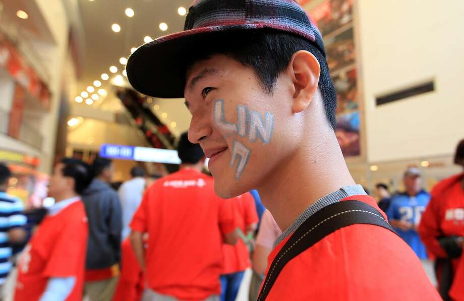 A Jeremy Lin fan in the lobby before the start of the home opener. (Karen Warren / Chronicle)