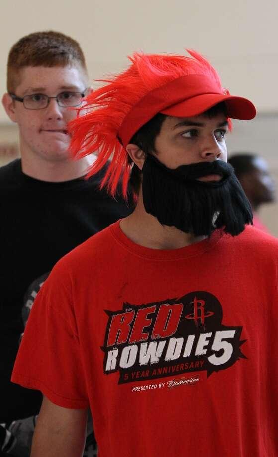 A Rockets fan sports a beard before the start of the home opener. (Karen Warren / Chronicle)