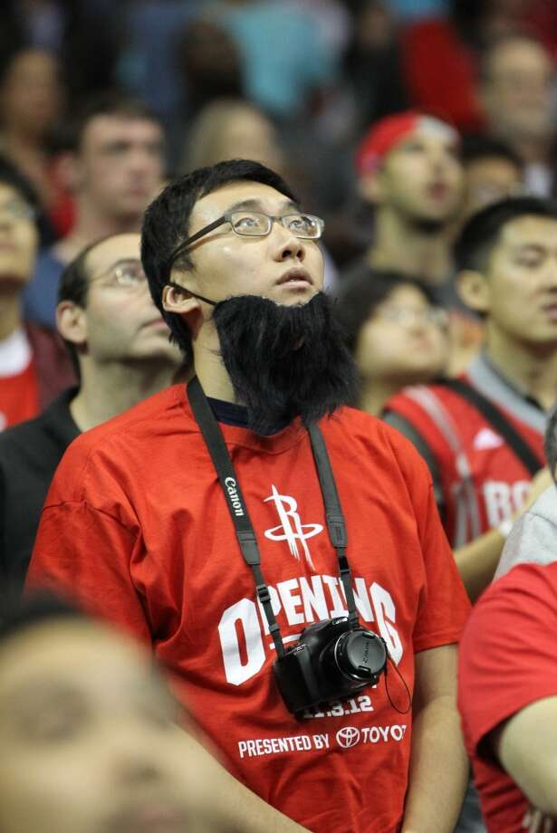 A Rockets fan wears a beard during the first half of the home opener. (Karen Warren / Chronicle)