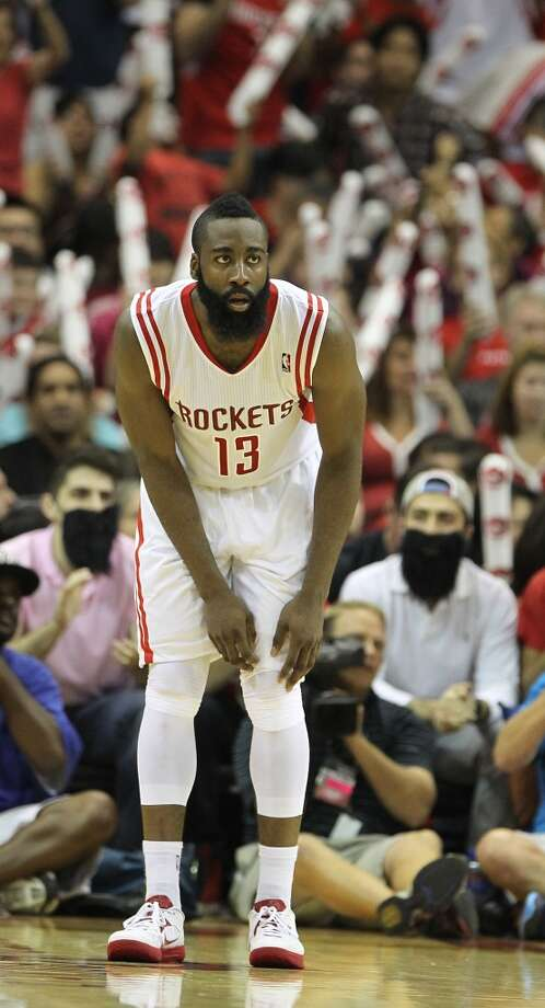 James Harden with fans with beards in the background during the second half. (Karen Warren / Chronicle)