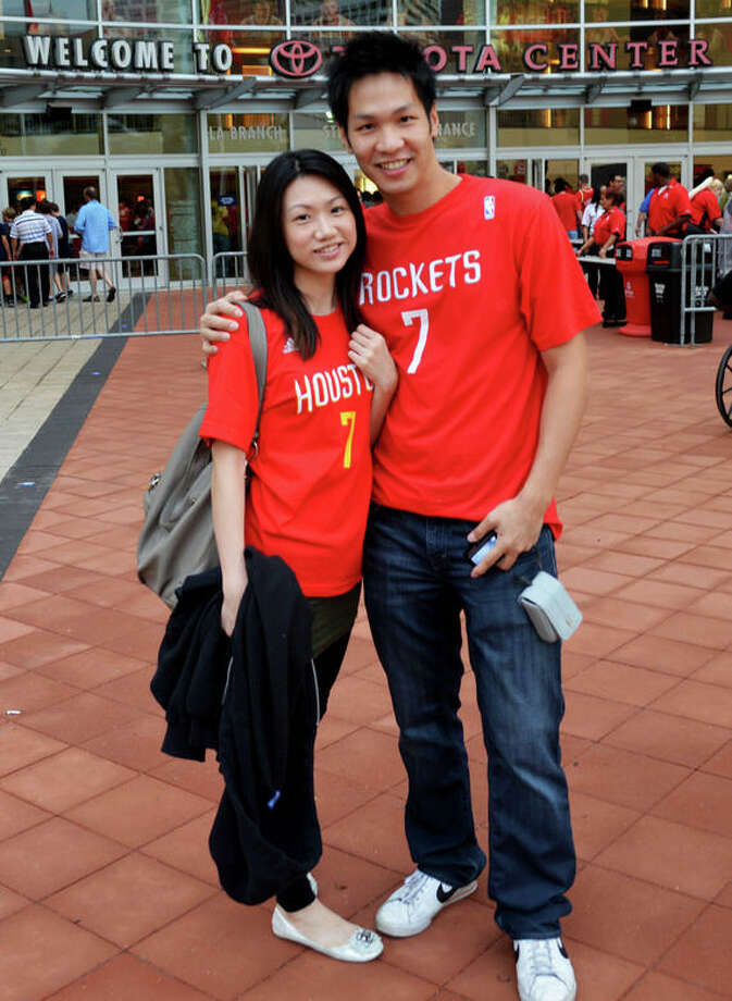 Chung-Sheng Ku & Ching-Yueh Lin at the first Rockets home game of the 2012-13 season against the Portland Trail Blazers on Sat. Nov 3. (Buck Bedia / For the Chronicle)