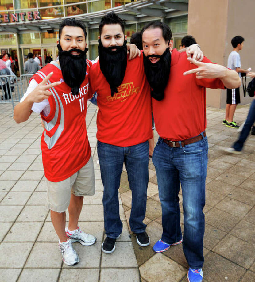 Quoc Nquyen, Ryan Roche and Andrew Vo at the first Rockets home game of the 2012-13 season against the Portland Trail Blazers on Sat. Nov 3. (Buck Bedia / For the Chronicle)
