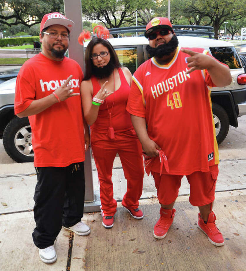Paul Granados, Vanessa Pena, and Sergio Pena are RED HOT at the first Rockets home game of the 2012-13 season against the Portland Trail Blazers on Sat. Nov 3. (Buck Bedia / For the Chronicle)