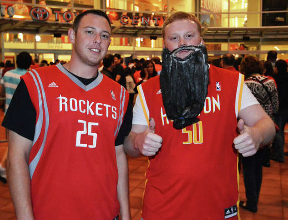Brent Baker and Dane Skarbovog improvised with what they had to make a beard at the first Rockets home game of the 2012-13 season against the Portland Trail Blazers on Sat. Nov 3. (Buck Bedia / For the Chronicle)