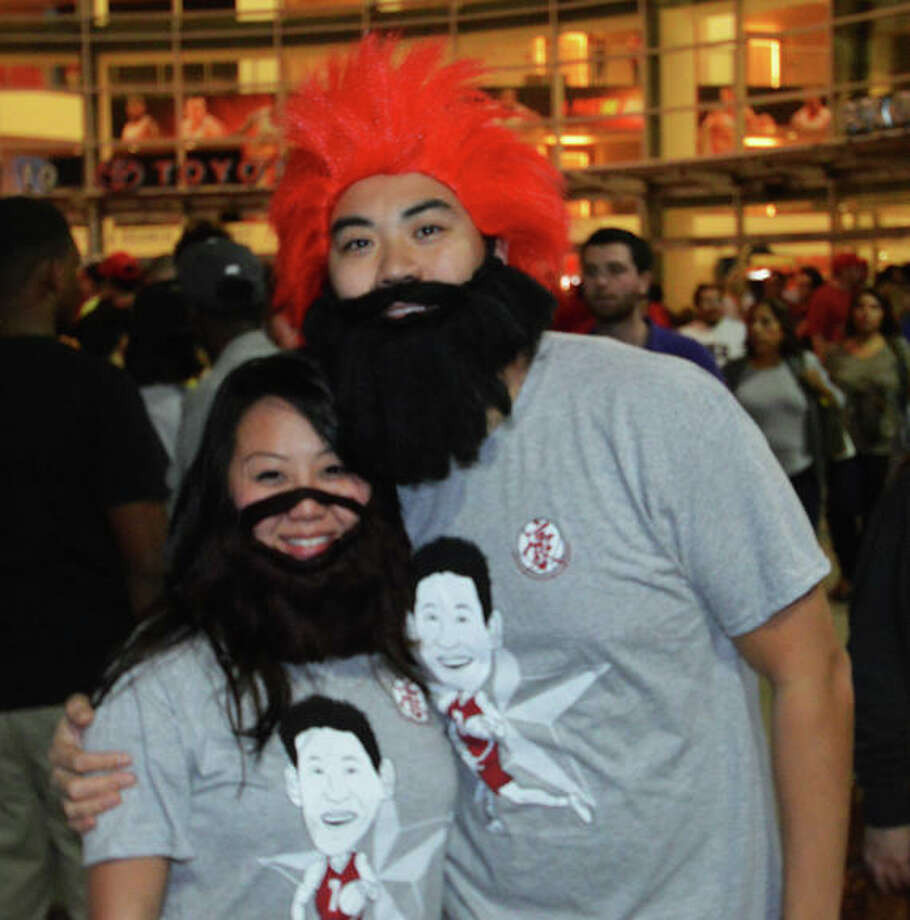 Tommy Tran and Anh Lu came out to support the two new players at the first Rockets home game of the 2012-13 season against the Portland Trail Blazers on Sat. Nov 3. (Buck Bedia / For the Chronicle)