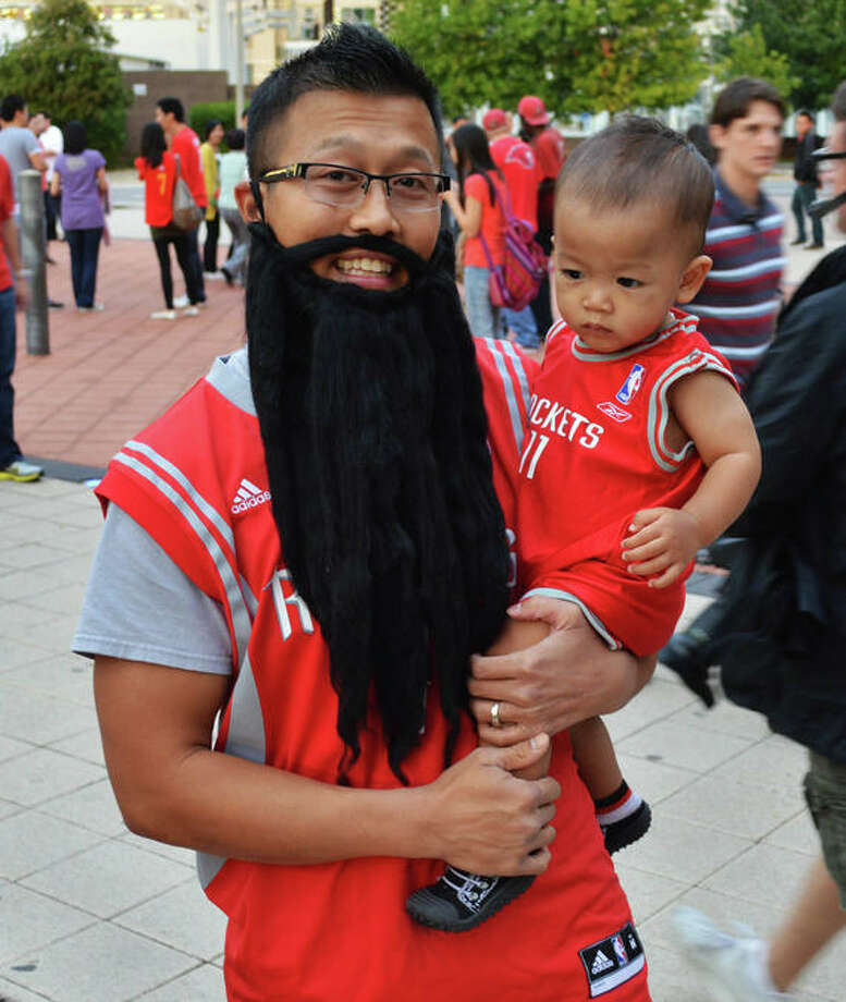 David Vuong brought his son Hyacinth to his first Rockets game against the Portland Trail Blazers on Sat. Nov 3. (Buck Bedia / For the Chronicle)