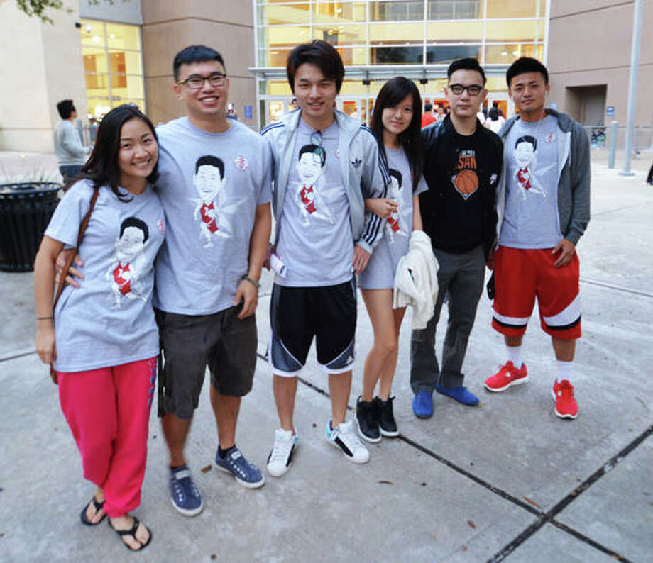 Yang Broderick, Tim Lu, Shi Kin, Donglai Du, Yi Lu at the first Rockets home game of the 2012-13 season against the Portland Trail Blazers on Sat. Nov 3. (Buck Bedia / For the Chronicle)