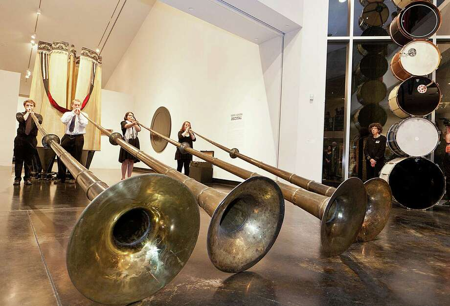 Skidmore College students perform using Terry Adkins sculptures ? four 18-foot-long horns ? which are part of his exhibition at the college?s Tang Museum. The students will perform songs inspired by Adkins at the museum, 815 Broadway, Saratoga Springs, at 8 p.m. Thursday. / Philip Scalia 2012