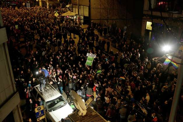 Crowds took to the streets to celebrate following a second term win by President Barack Obama on election night Tuesday, November 6, 2012, on Capitol Hill in Seattle, Wash. Beforehand, crowds had flocked to return parties hosted by a number of bars in the area to wait out final ballot results. In addition to President Barack Obama's reelection, Referendum 74 and I-502 were both passed in Washington state. Photo: JORDAN STEAD / THE EMERALD COLLECTIVE / FOR SEATTLEPI.COM