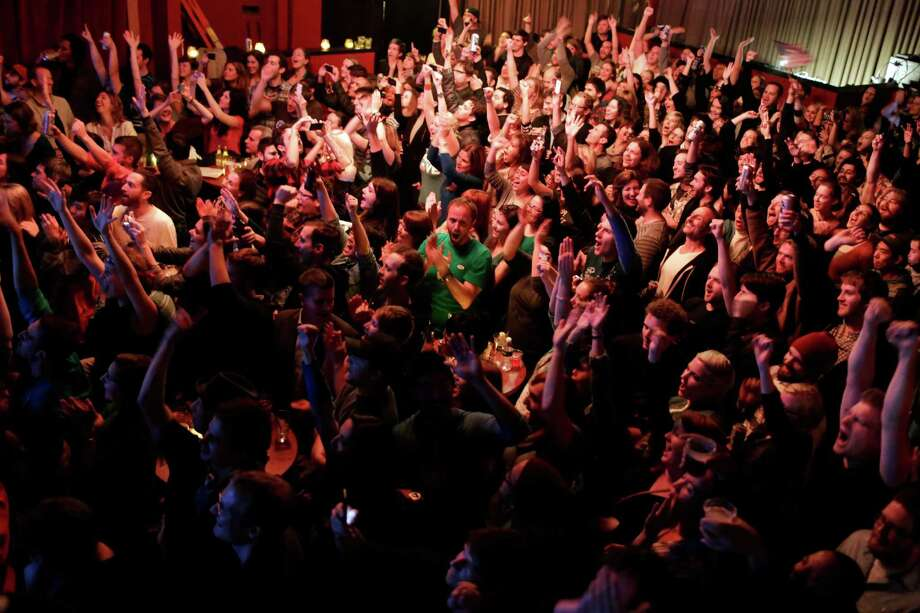 Hundreds of onlookers cheer as one of President Barack Obama's state wins appears on a projected TV screen on election night Tuesday, November 6, 2012, on Capitol Hill in Seattle, Wash. Crowds flocked to return parties hosted by a number of bars in the area to wait out final ballot results. In addition to President Barack Obama's reelection, Referendum 74 and I-502 were both passed in Washington state. Photo: JORDAN STEAD / THE EMERALD COLLECTIVE / FOR SEATTLEPI.COM