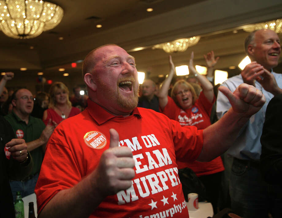 Chris Murphy supporter Ron Frost of Middlefield reacts as he watches the election results at Murphy headquarters at the Hilton Hotel in Hartford on Tuesday, November 6, 2012. Photo: Brian A. Pounds / Connecticut Post