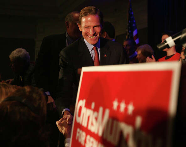 Sen. Richard Blumenthal shakes hands as he takes the stage for Chris Murphy's victory speech at the Hilton Hotel