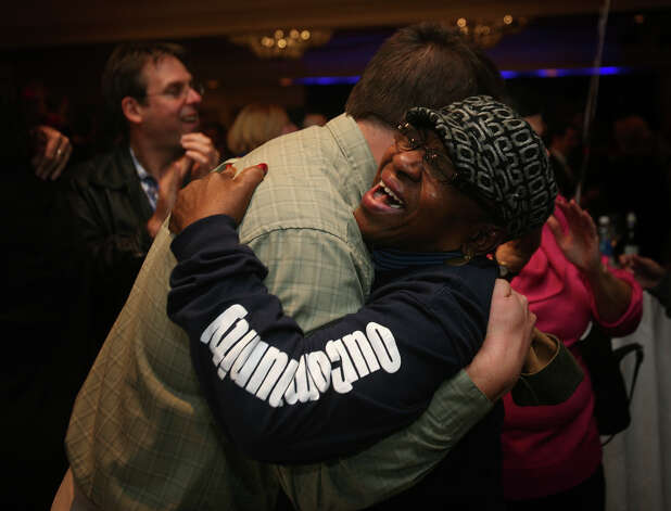 Walter Modliszewski of Tolland and Estella Knight of Hartford embrace after learning of President Barack Obama's re-election at Chris Murphy headquarters at the Hilton Hotel in Hartford on Tuesday, November 6, 2012. Photo: Brian A. Pounds / Connecticut Post