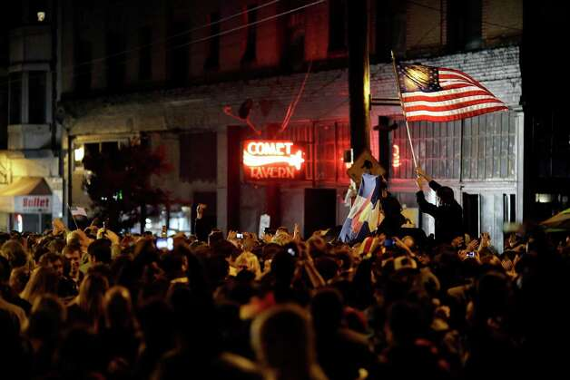Crowds took to the streets to celebrate following a projected second term win by President Barack Obama on on election night Tuesday, November 6, 2012, on Capitol Hill in Seattle, Wash. Crowds flocked to return parties hosted by a number of bars in the area to wait out final ballot results. In addition to President Barack Obama's reelection, Referendum 74 and I-502 were both passed in Washington state. Photo: JORDAN STEAD / THE EMERALD COLLECTIVE / FOR SEATTLEPI.COM
