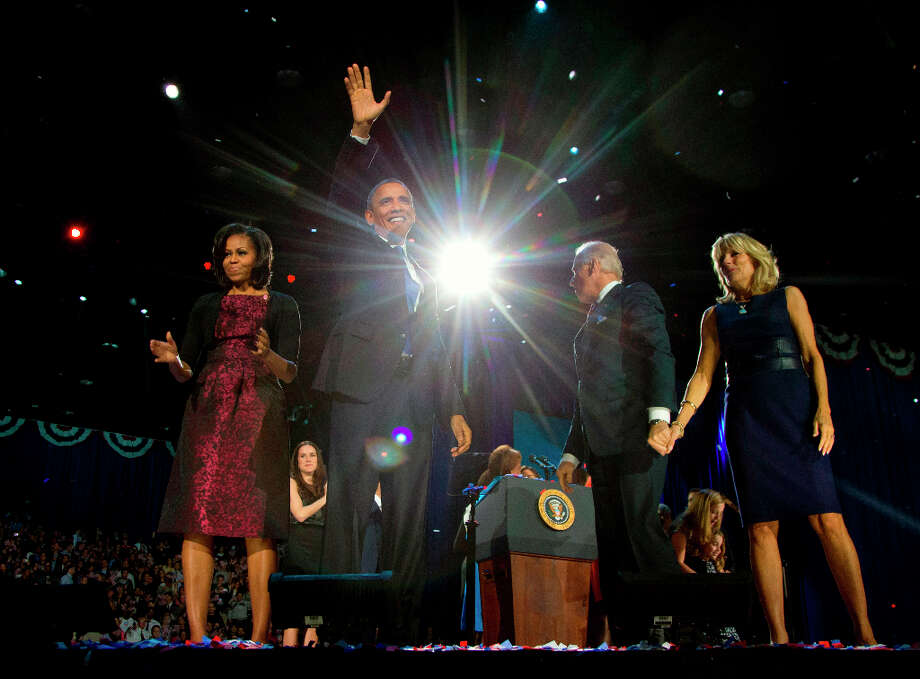 President Barack Obama with first last Michelle Obama, Vice President Joe Biden and Jill Biden celebrate on stage at the election night party at McCormick Place, early Wednesday, Nov. 7, 2012, in Chicago. Obama defeated Republican challenger former Massachusetts Gov. Mitt Romney. Photo: Carolyn Kaster, Associated Press / AP