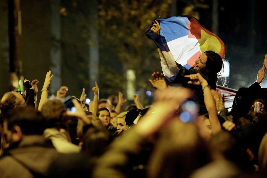 Crowds took to the streets to celebrate following a projected second term win by President Barack Ob