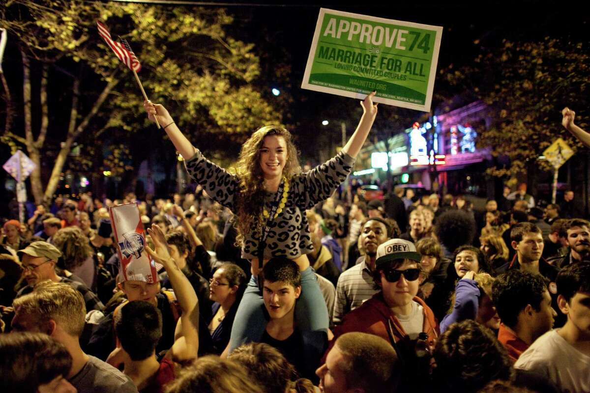 Seattle University student Victoria Czorny rides on the shoulders of a friend as a spontaneous party erupts in the intersection of East Pike Street and 10th Avenue after Barack Obama was announced as the winner, Referendum 74 appeared to be passing and a measure to legalize marijuana also seemed to be passing on Election Day, Tuesday, November 6, 2012.