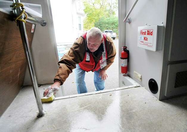Red Cross volunteer Gary Redder of Bridgeport cleans the floor of the ERV (Emergency Response Vehicle) at the Red Cross headquarters on Brooklawn Avenue in Bridgeport, Conn. on Wednesday, Nov. 7, 2012. Efforts were underway to clean and organize equipment used during Hurricane Sandy while keeping an eye on the weather as a nor'easter approaches Connecticut this week. Photo: Cathy Zuraw / Connecticut Post