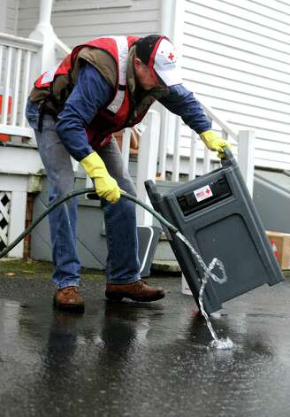 Red Cross volunteers John Stewart of Wilton cleans out the Cambro beverage dispensers at the Red Cross headquarters on Brooklawn Avenue in Bridgeport, Conn. on Wednesday, Nov. 7, 2012. Efforts were underway to clean and organize equipment used during Hurricane Sandy while keeping an eye on the weather as a nor'easter approaches Connecticut this week. Photo: Cathy Zuraw / Connecticut Post