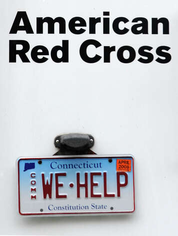 "The license plate on the Red Cross ERV (Emergency Response Vehicle) says it all  - ""WE HELP"". Staff and volunteers were at the Red Cross headquarters on Brooklawn Avenue in Bridgeport, Conn. on Wednesday, Nov. 7, 2012, preparing for future shelters as a nor'easter approaches Connecticut. Photo: Cathy Zuraw / Connecticut Post"