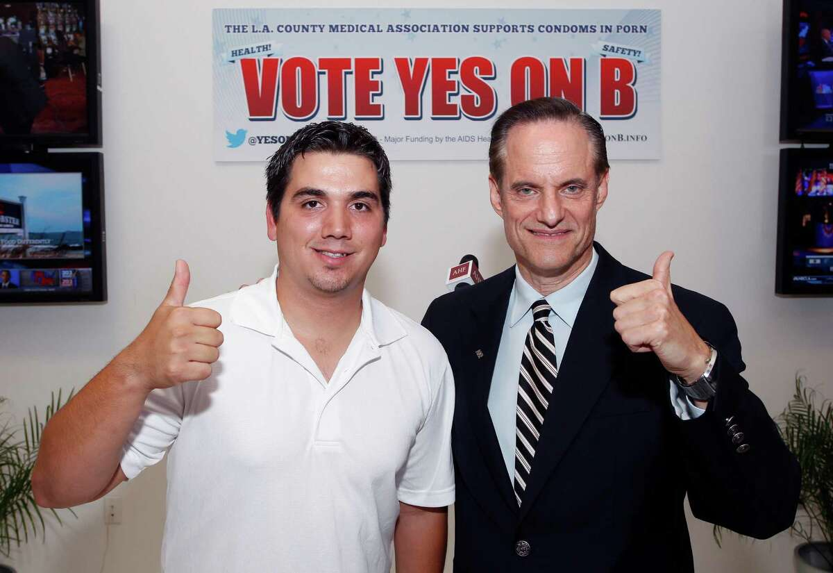 IMAGE DISTRIBUTED FOR AIDS HEALTHCARE FOUNDATION - Michael Weinstein, AIDS Healthcare Foundation, President & Measure B Proponent, right, and former adult film performer Derrick Burts are seen at the AIDS Healthcare Foundation Election Headquarters victory party on Tuesday, November 6, 2012 in Los Angeles, California. Early results show strong support for Measure B. (Joe Kohen/AP Images for AIDS Healthcare Foundation)