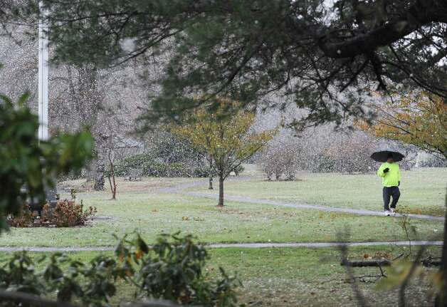 A man walks at Binney Park during the Nor'easter in Old Greenwich, Conn., Wednesday, Nov. 7, 2012. Photo: Helen Neafsey / Greenwich Time