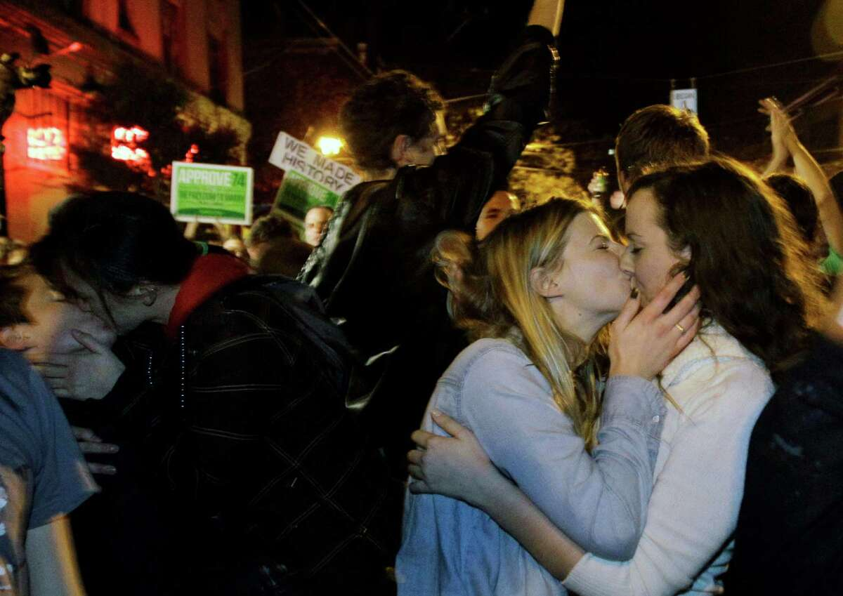 Revelers kiss in Capitol Hill on Nov. 7, 2012, as they celebrate early election returns legalizing gay marriage in Washington. The re-election of President Obama and passage of Referendum 74 supporters to the streets.