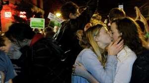 Revelers kiss as they celebrate early election returns favoring Washington state Referendum 74, which would legalize gay marriage, during a large impromptu street gathering in Seattle's Capitol Hill neighborhood, in the early hours of Wednesday, Nov. 7, 2012. The re-election of President Barack Obama and Referendum 74 drew the most supporters to the streets.