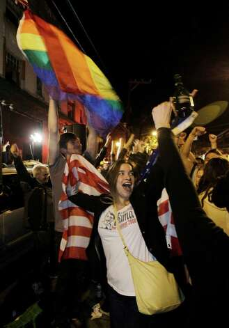 Revelers display U.S. and gay pride flags as they celebrate early election returns favoring Washington state Referendum 74, which would legalize gay marriage, during a large impromptu street gathering in Seattle's Capitol Hill neighborhood, in the early hours of Wednesday, Nov. 7, 2012. The re-election of President Barack Obama and Referendum 74 drew the most supporters to the streets. Photo: TED S. WARREN / ASSOCIATED PRESS