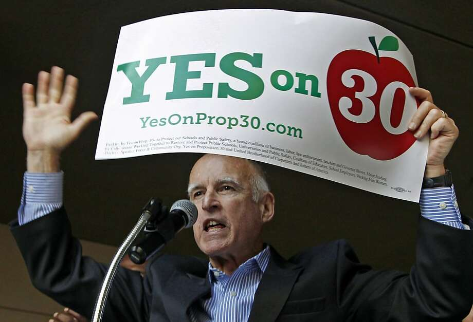 Gov. Jerry Brown speaks at a rally in downtown Los Angeles on Saturday, Nov. 3, 2012 for precinct walkers from the Service Employees International Union (SEIU), calling for their help in getting out the vote for Proposition 30, in a final weekend of campaigning. (AP Photo/Reed Saxon) Photo: Reed Saxon, Associated Press