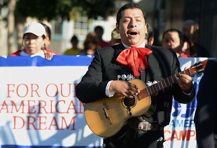 Mariachi musicians sing and play serenadas as they go from house to house to encourage people to come to vote on election day in the predominantly Latino Sun Valley district of Los Angeles on November 6, 2012. From Mexican Americans and Puerto Ricans to Cuban Americans, the more than 12 million Hispanic Americans eligible to vote could hold the keys to the White House.    AFP PHOTO /JOE KLAMARJOE KLAMAR/AFP/Getty Images Photo: Joe Klamar, AFP/Getty Images