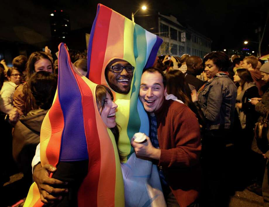 People celebrate early election returns favoring Washington state Referendum 74, which would legalize gay marriage, during a large impromptu street gathering in Seattle's Capitol Hill neighborhood, Tuesday, Nov. 6, 2012. The re-election of President Barack Obama and Referendum 74 drew the most supporters to the streets. Photo: TED S. WARREN / ASSOCIATED PRESS