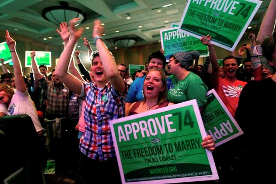 Supporters cheer at an election watch party for proponents of Referendum 74, which would uphold the state's new same-sex marriage law, Tuesday, Nov. 6, 2012, in Seattle. Photo: Elaine Thompson