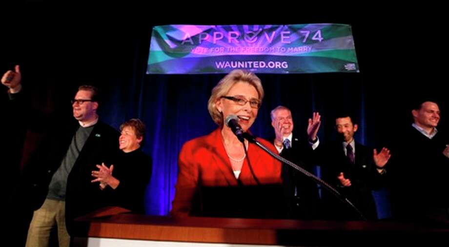 Gov. Chris Gregoire, center, speaks as other elected officials stand behind at an election watch party for proponents of Referendum 74, which would uphold the state's new same-sex marriage law, Tuesday, Nov. 6, 2012, in Seattle. Photo: Elaine Thompson
